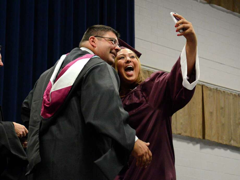 Lauren Belardinelli takes a quick selfie after she receives her diploma during Bethel High Schools Commencement Ceremony that took place at Western Connecticut State University in the O'Neill Center on Monday June 23, 2014. Photo: Lisa Weir / The News-Times Freelance