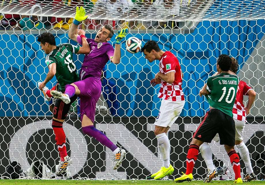 Croatia's Dejan Lovren (in red) clears a ball off the line, but his  efforts weren't enough to hold off Mexico. Photo: Miguel Tovar, Getty Images