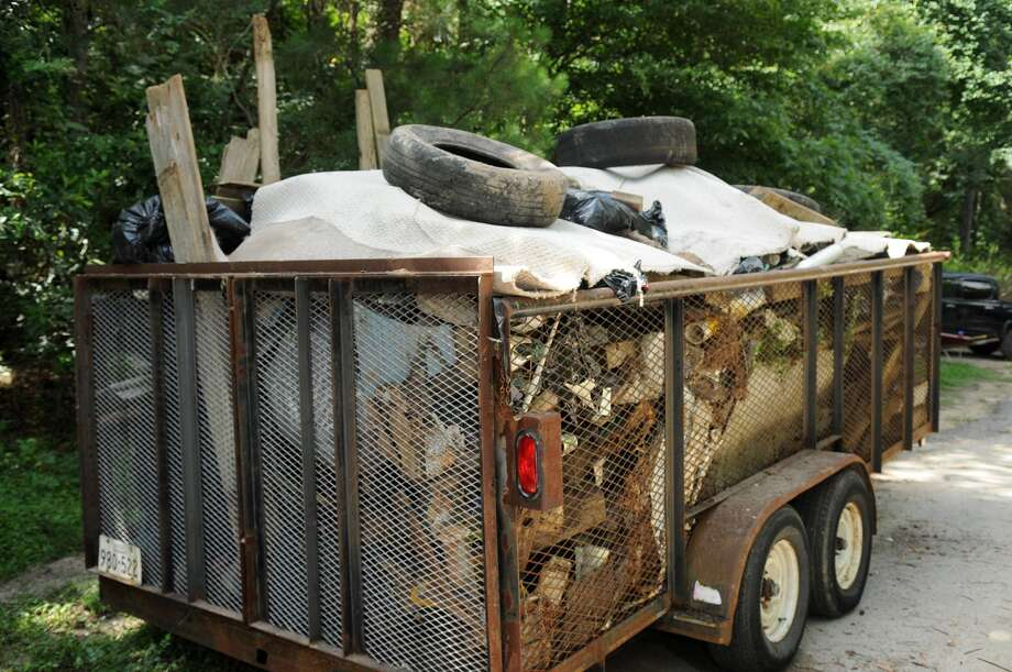 A trailer full of trash is evidence of the work done during a Spring Creek Greenway cleanup. Photo: Jerry Baker, For The Chronicle