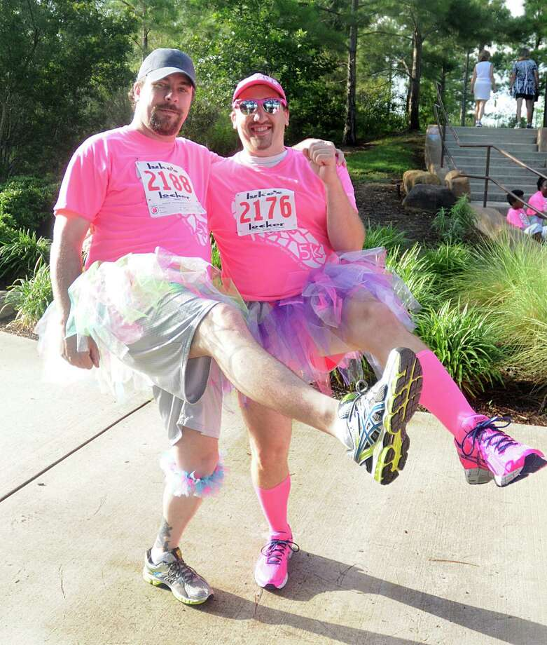 "Kelly Whitley and Jon Erion, both of Spring 77388, perform a high kick for the ""Fight Like a Girl"" team members during The Pink 5K walk/Run, against breast cancer, at Creekside Park in The Woodlands. The run will benefit the Breast Cancer Charities of America. Photograph by David Hopper Photo: David Hopper, For The Chronicle / freelance"