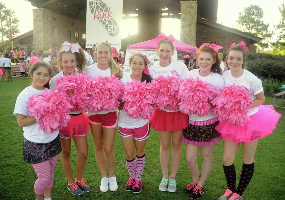 The Woodlands Christian Academy cheerleaders Laura Walker, Logan Lusk, Rylie Ray, Sam Thomas, Darcy Sanford, Chloe Scrushy, and Kristen Casey volunteered to cheer runners during The Pink 5K walk/Run, against breast cancer, at Creekside Park in The Woodlands. The run will benefit the Breast Cancer Charities of America. Photograph by David Hopper Photo: David Hopper, For The Chronicle / freelance