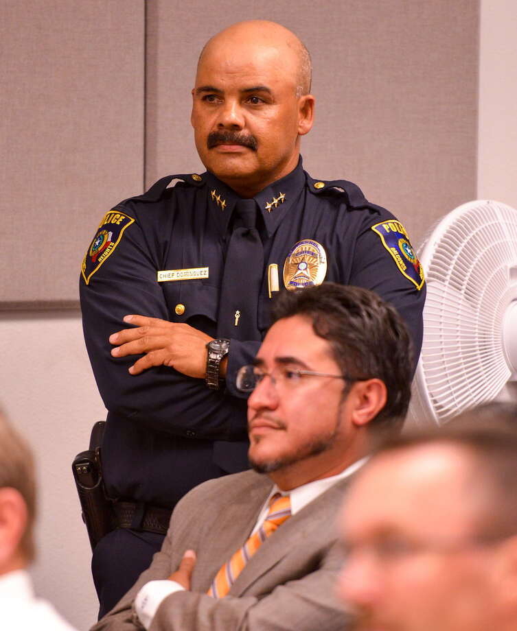 Balcones Heights Police Chief Henry Dominguez and his attorney Mark Anthony Sanchez at the City Council meeting. Dominguez is on paid administra- tive leave while an officer's complaint about him is investigated. Photo: Robin Jerstad / For The San Antonio Express-News