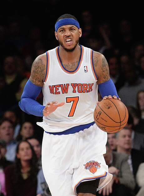 Free-agent forward Carmelo Anthony might have to weigh a maximum contract versus the chance to win a championship. Photo: EMMANUEL DUNAND, Staff / AFP