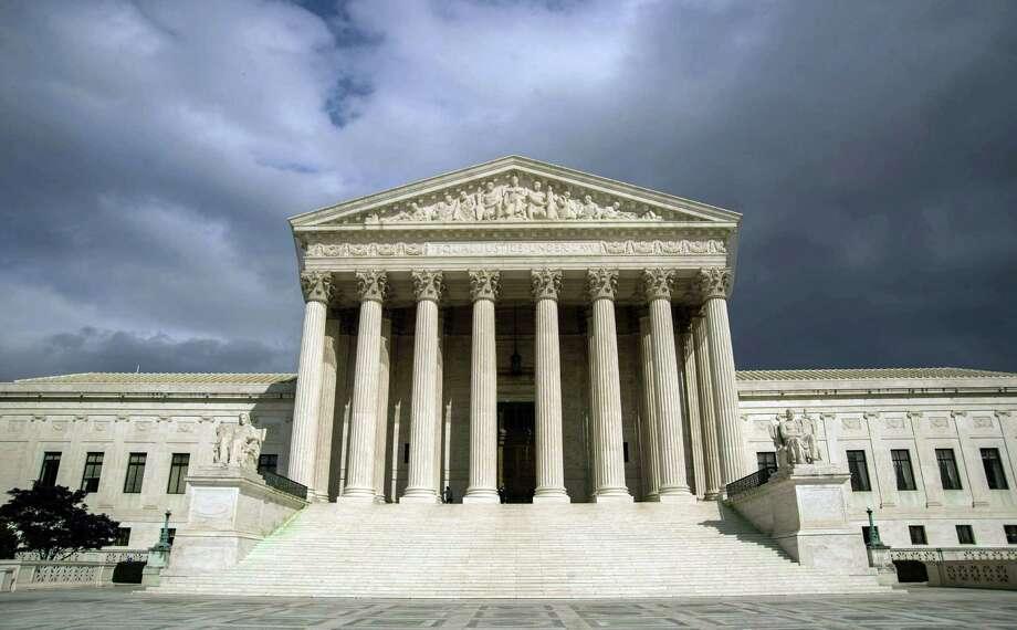 The US Supreme Court Building is seen in Washington, DC. AFP PHOTO/Karen BLEIER/FILESKAREN BLEIER/AFP/Getty Images Photo: KAREN BLEIER, Staff / AFP ImageForum