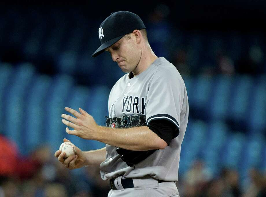 New York Yankees starting pitcher Chase Whitley reacts on the mound while playing against the Toronto Blue Jays during the second inning of a baseball game in Toronto on Monday, June 23, 2014. (AP Photo/The Canadian Press, Nathan Denette) ORG XMIT: NSD108 Photo: Nathan Denette / The Canadian Press