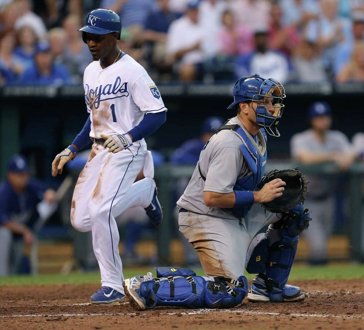 KANSAS CITY, MO - JUNE 23: Jarrod Dyson #1 of the Kansas City Royals crosses home to score past A.J. Ellis #17 of the Los Angeles Dodgers on a Lorenzo Cain single in the fifth inning at Kauffman Stadium on June 23, 2014 in Kansas City, Missouri. (Photo by Ed Zurga/Getty Images) ORG XMIT: 477585465