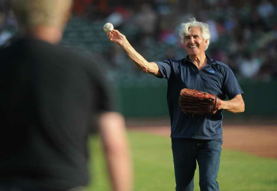Former senate majority leader Joe Bruno warms up his arm before throwing out the first pitch for the Tri-City ValleyCats baseball game against the Vermont Lake Monsters at the Joe Bruno Stadium Monday, June 23, 2014 in Troy, N.Y.  (Lori Van Buren / Times Union) Photo: Lori Van Buren / 00027454A