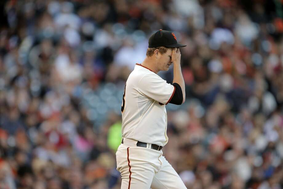 Matt Cain wipes his brow after giving up a hit double that scored two runs in the fourth inning. The San Francisco Giants played the San Diego Padres at AT&T Park in San Francisco, Calif., on Monday, June 23, 2014, losing 6-0. Photo: Carlos Avila Gonzalez, The Chronicle