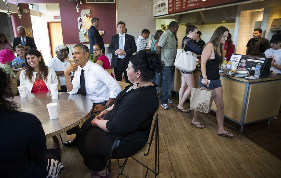President Obama joins several parents for lunch at a restaurant in Washington, where they participated in a White House summit on working families. Photo: Doug Mills, New York Times