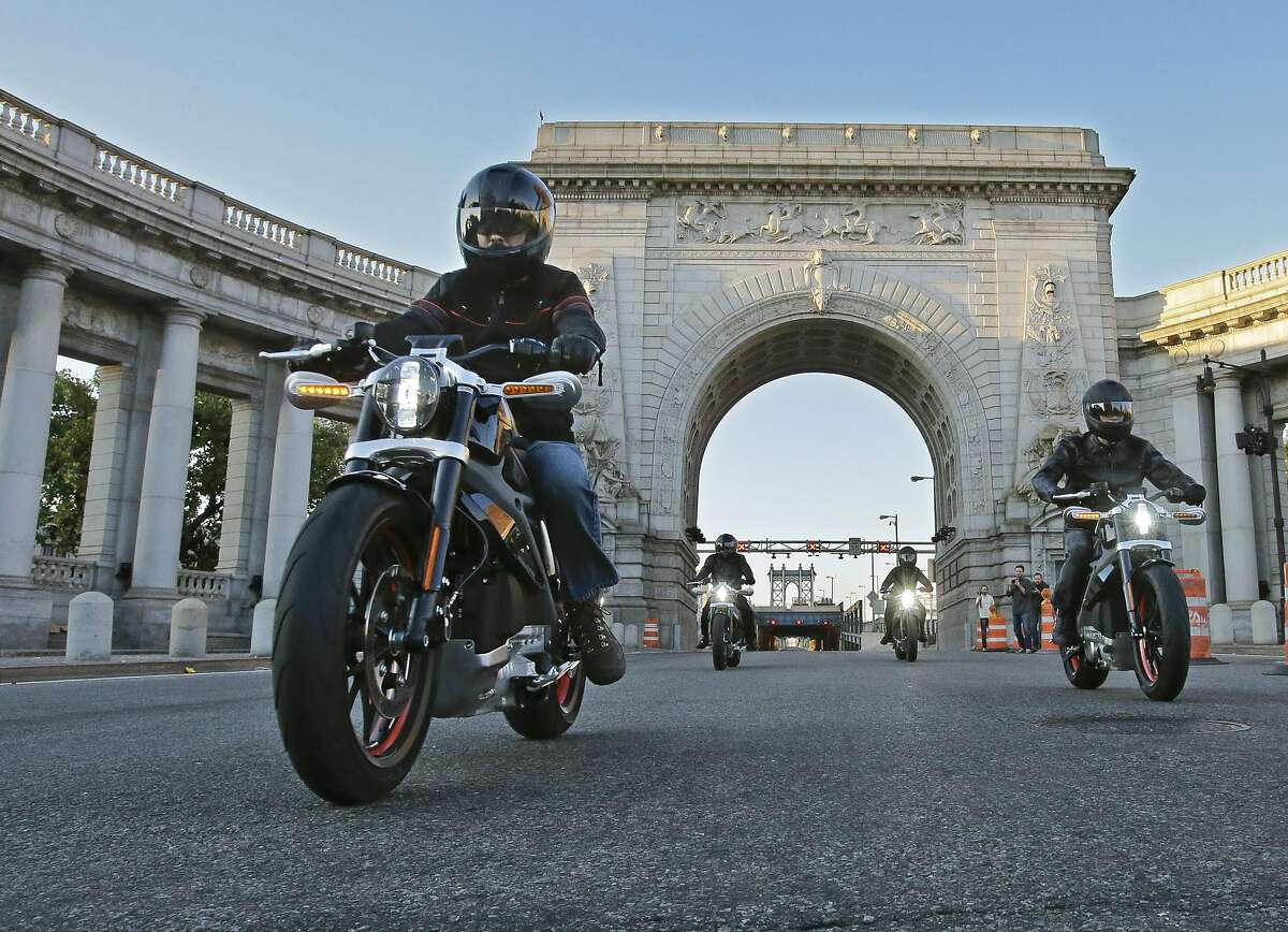 In this photo provided by Harley-Davidson, riders introduce Project LiveWire-the first electric Harley-Davidson motorcycle-as they cross the Manhattan Bridge in New York, Monday, June 23, 2014. While not for sale, starting today, select consumers across the United States will be able to ride and provide feedback on the new motorcycle during a series of events scheduled through the remainder of the year. Harley said it will likely be several years before its LiveWire goes on sale.