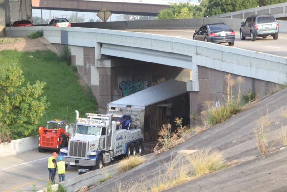 An overturned big rig snarled traffic for hours Tuesday morning on U.S. 59 near Interstate 10 near downtown on Tuesday, blocking the southbound Eastex Freeway ramp to the outbound East Freeway. (Photo by Cody Duty/Houston Chronicle)