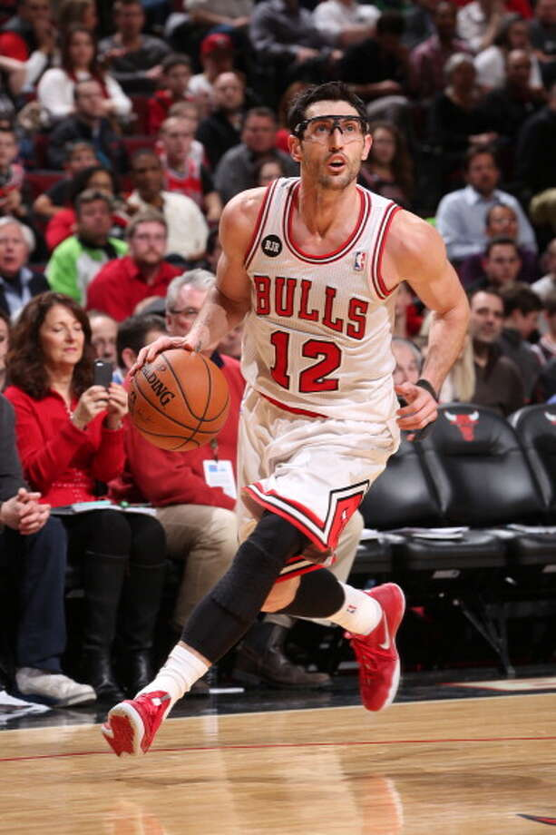 Kirk Hinrich Point guard Age: 33 Status: Agreed to re-sign with Chicago Bulls. Photo: Gary Dineen, NBAE/Getty Images / 2014 NBAE