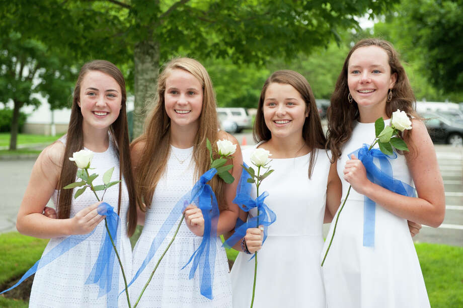 New Canaan Country School ninth-graders Stella Noels, Phoebe Slaughter, Lily von Stade and Maddie Smith, from left to right, are all smiles on their recent graduation day. Photo: Contributed Photo, Contributed / New Canaan News