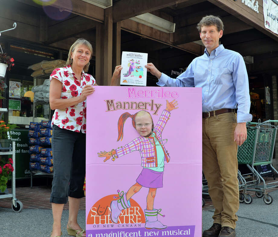 Melody Libonati, artistic director of the Summer Theatre of New Canaan and Alex Stewart, general manager of Walter Stewart's Market congratulate 7-year-old Madeline Scanlon, center, as the winner of the store's coloring contest. Photo: Contributed Photo, Contributed / New Canaan News