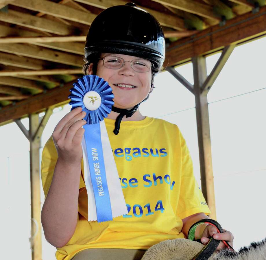 "Andrew Baylis, of Darien, earned his therapeutic riding class' ""Best Use of Aids"" award at the 33rd annual Pegasus Horse Show June 7. Photo: Contributed Photo, Contributed / Darien News"