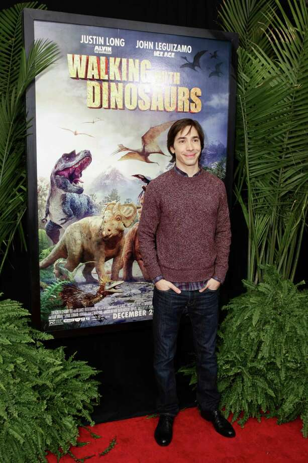 "Actor Justin Long, who grew up in Fairfield, Conn., attends the ""Walking With Dinosaurs"" screening at Cinema 1, 2 & 3 on Dec. 15, 2013 in New York City. The movie is among those featured during a free kids summer movie series that will run through August 2014. Photo: Andrew Toth, WireImage / Stamford Advocate Contributed photo"