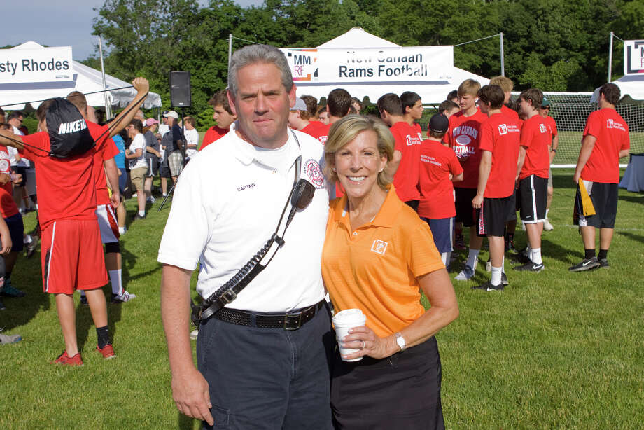 New Canaan Fire Department Captain Mike Socci with Kathy Giusti at the 11th annual Multiple Myeloma Research Foundation Race for Research: Tri-State 5K Walk/Run, at New Canaan High School Sunday, June 8, 2014. Photo: Contributed Photo, Contributed / New Canaan News Contributed