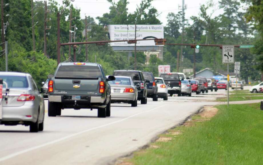 Traffic moves northbound on FM 2978 at Woodlands Parkway. The planned expansion of the roadway between The Woodlands and Tomball is expected to drive the growth of retail and housing along the route. Photo: David Hopper, Freelance / freelance