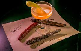"""The """"Evil Twin"""" cocktail with a section of died sausages at Thirdrail in San Francisco,  Calif., on Friday, June 20th, 2014."""