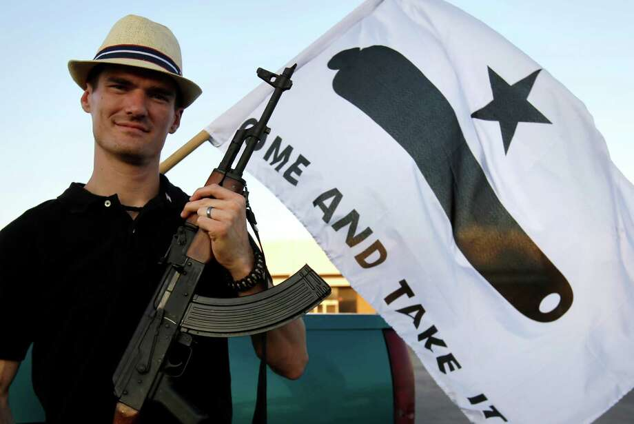 Kory Watkins, coordinator for Open Carry Tarrant County poses for a portrait holding his Romanian AK 47, Thursday, May 29, 2014, in Haltom City, Texas. Watkins is among the leaders of Cop Block, a group that films police officers at work. (File photo) Photo: Tony Gutierrez, AP / AP2014