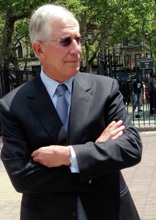 "Greenwich resident Paul Konigsberg leaves federal court in New York on Tuesday, June 24, 2014 after he pleaded guilty to conspiracy and two counts of falsifying books and records in a co-operation deal with the government. The 78-year-old Konigsberg, an accounting firm executive who worked for Bernard Madoff, told the court he was not aware of Madoff's ""horrific and evil Ponzi scheme."" Madoff is serving a 150-year prison sentence after admitting his fraud in 2009. (AP Photo/Larry Neumeister) Photo: Larry Neumeister, Associated Press / Associated Press contributed"