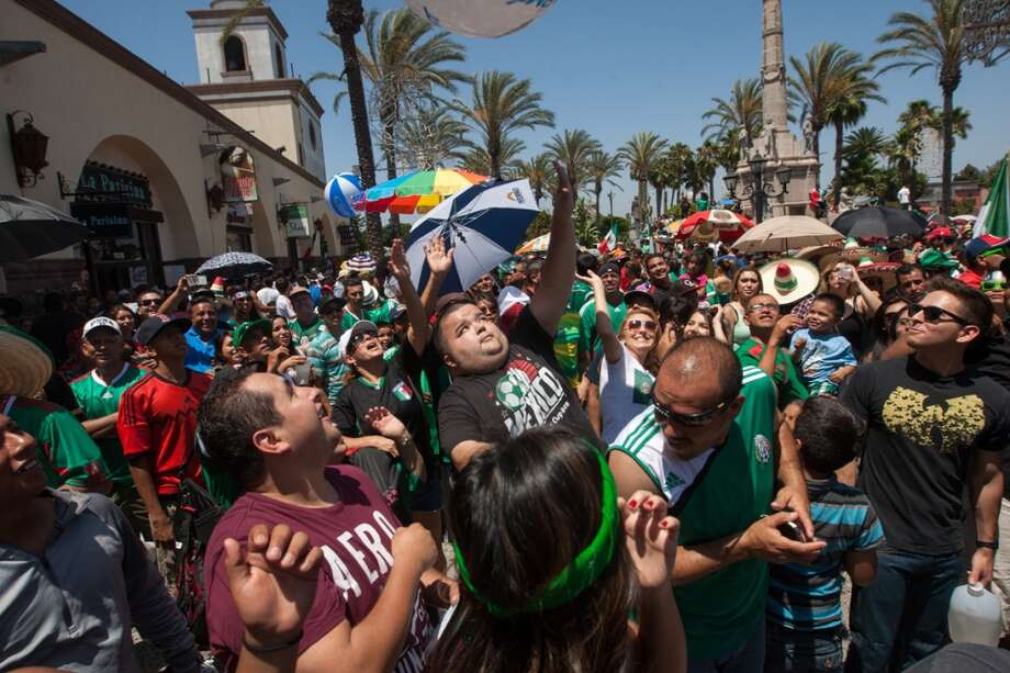 Mexico fans watch the Mexico-Croatia World Cup 1st round match at Plaza Mexico in Los Angeles. Photo: Douglas Zimmerman