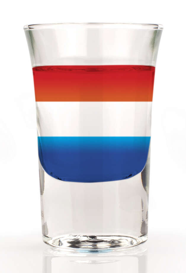 Malibu American Flag .75 parts Blue Curacao .75 parts Malibu Coconut Rum .75 parts Campari In a shot glass layer Blue Curacao, then Malibu and then Campari on the top for a very Patriotic-looking shooter or sipper. Photo: Madiz, Getty Images/iStockphoto / iStockphoto