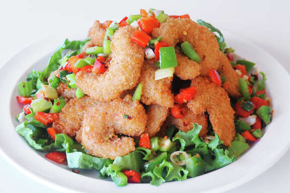 "Loving Hut's Spicy Cha Cha, a vegan stir-fry of fried ""shrimp,"" is featured in ""The HappyCow Cookbook."""