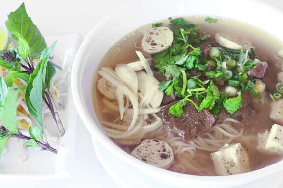 "Fabulous Pho: Aulacese (Vietnamese) Traditional Soup is a vegan-friendly pho served at Houston's Loving Hut restaurant and featured in ""The HappyCow Cookbook."""