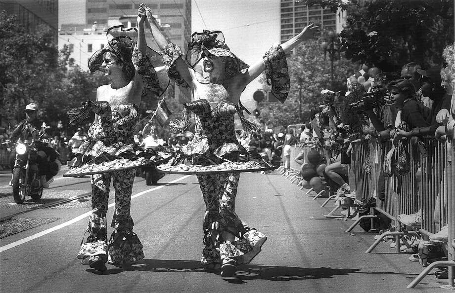 Two costumed men make their way down Market St. during theSan Francisco Gay Freedom Day Parade in '93. Photo: Michael Macor, STAFF