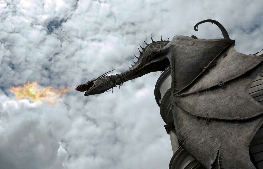 A dragon breathes fire from atop Gringnotts Bank during a preview of Diagon Alley at the Wizarding World of Harry Potter at Universal Orlando, Thursday, June 19, 2014, in Orlando, Fla. Photo: John Raoux, AP / AP