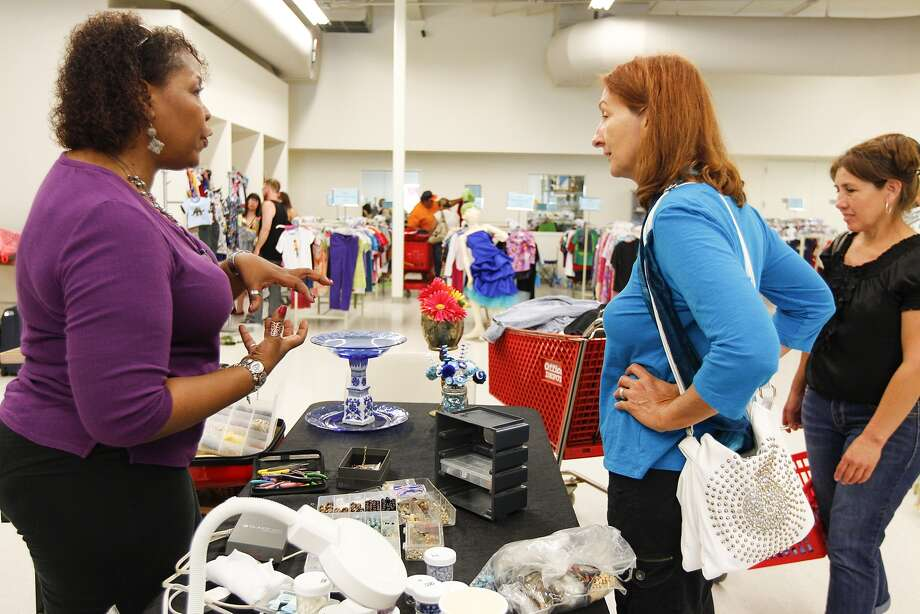 Katherin Sander, director of the Fort Bend County Women's Shelter, talks jewelry and home item recycling with store patron Diane Meyer during the June 4 grand opening of the PennyWise Resale Center in Richmond. Proceeds from the store benefit the Fort Bend County Women's Center which assists survivors of domestic violence and sexual assault.    Katherin Sander, director of the Fort Bend County Women's Shelter, talks jewelry and home item recycling with store patron Diane Meyer during the June 4 grand opening of the PennyWise Resale Center in Richmond. Proceeds from the store benefit the Fort Bend County Women's Center which assists survivors of domestic violence and sexual assault. Photo: Diana L. Porter, Freelance / © Diana L. Porter