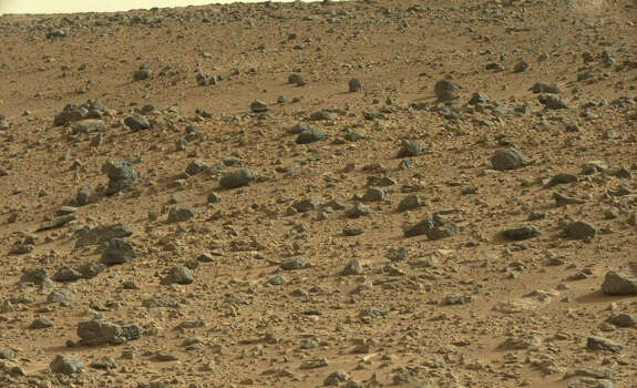 """A cat on Mars? A blogger who maintains the site """"Mars Anomalies, UFO Sightings and More"""" pointed out the feline shape in a NASA Mars rover photo.Can you see it? Photo: NASA Rover Image"""