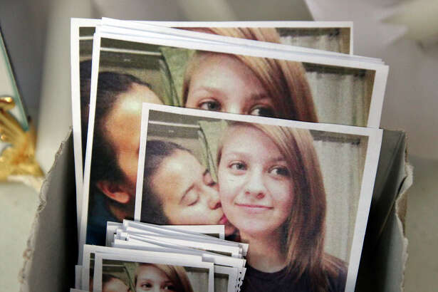 Photos of Mary Kristene Chapa (left) and her girlfriend Mollie Judith Olgin that were given to people attending a candle light vigil for the girls Friday June 29, 2012 at Woodlawn Lake. Olgin, 19, and Chapa, 18, were found shot in the head Saturday in a Portland, Tx park.  Olgin died at the scene and Chapa is in stable condition in the hospital.