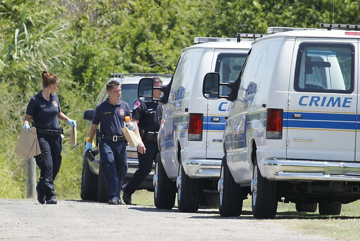 Crimes scene investigators take evidence back to their vans Saturday, June 23, 2012 at Violet Andrews Park in Portland, Texas. Gay rights groups have called for a thorough police investigation into the fatal shooting of a teenage woman and wounding of her girlfriend in the park.