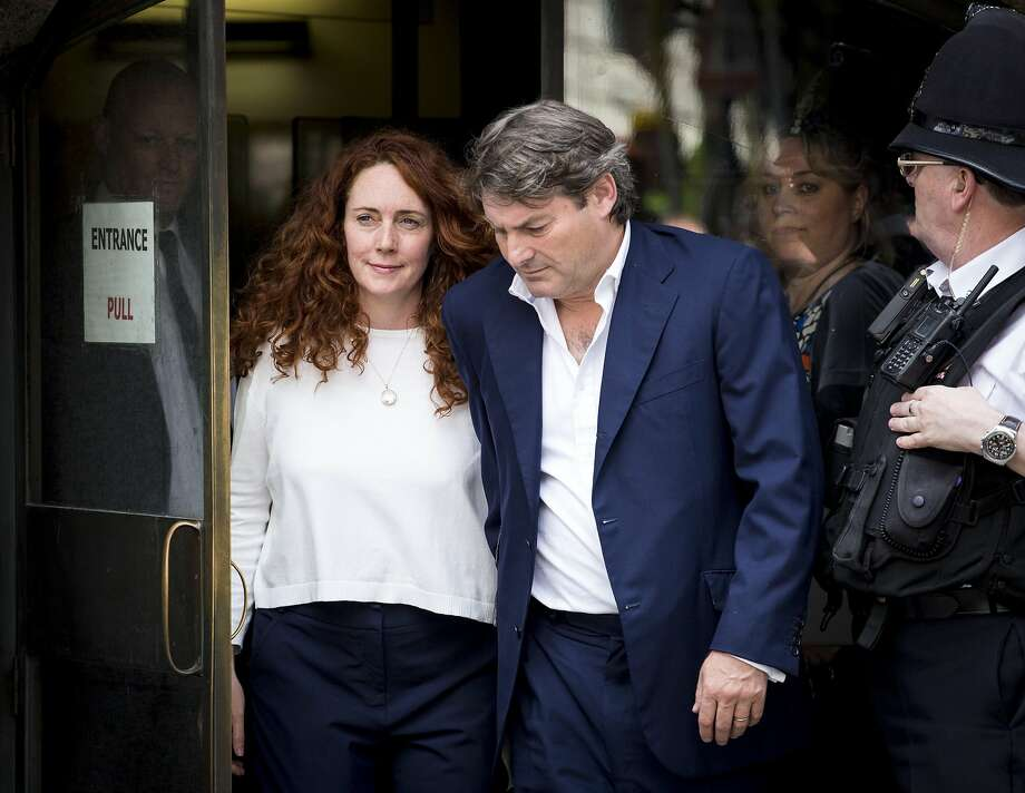Rebekah Brooks and her husband, Charlie Brooks, leave London's Old Bailey courthouse after the former head of Rupert Murdoch's newspaper holdings in Britain was found not guilty in a newspaper scandal. Photo: John Phillips, Getty Images