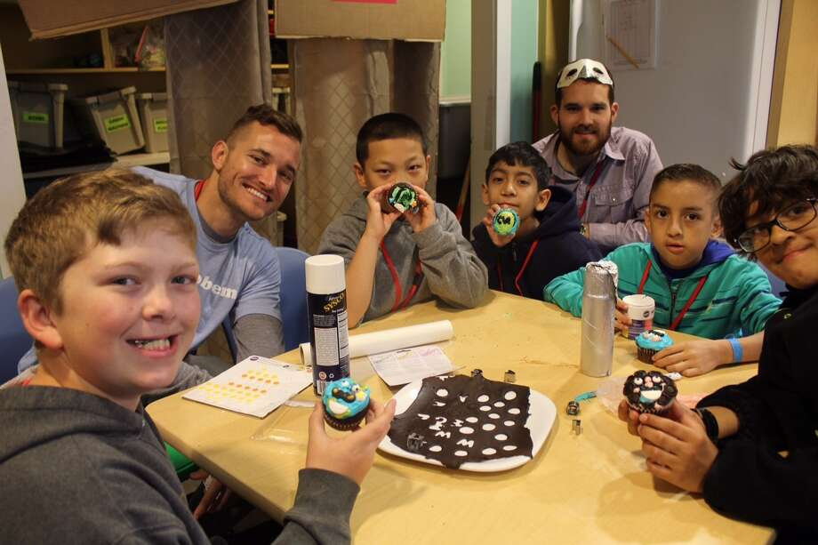 Deer Park resident Jordan Marshburn, left, enjoys cupcakes with fellow campers at Keep Smiling Camp for children with cleft lip and palate issues. Photo: Keep Smiling Camp