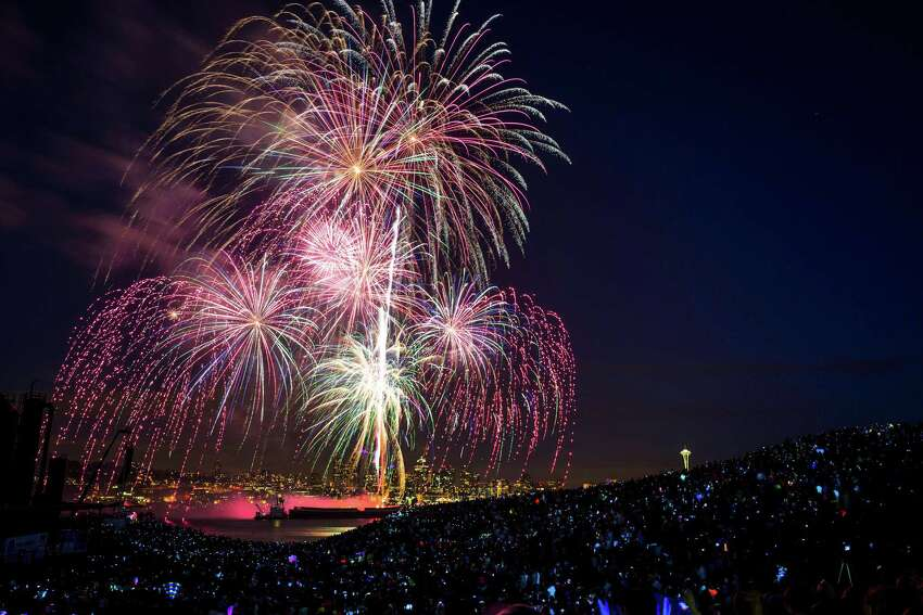 July 4, 2013 � Smartphone screens mirror the colors of fireworks exploding over Lake Union during the Seafair Summer Fourth event as seen from Gas Works Park. (Jordan Stead, seattlepi.com)
