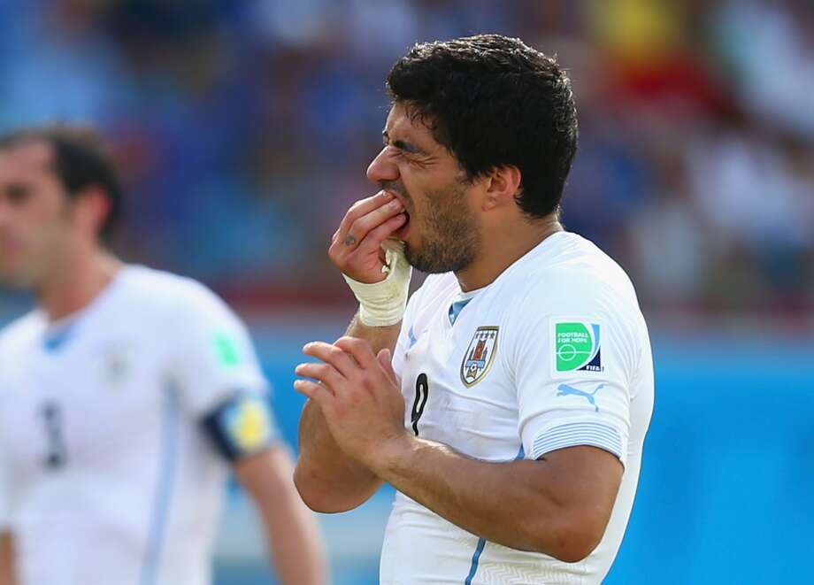 Luis Suarez of Uruguay reacts during the 2014 FIFA World Cup Brazil Group D match between Italy and Uruguay at Estadio das Dunas on June 24, 2014 in Natal, Brazil. Photo: Clive Rose, Getty Images