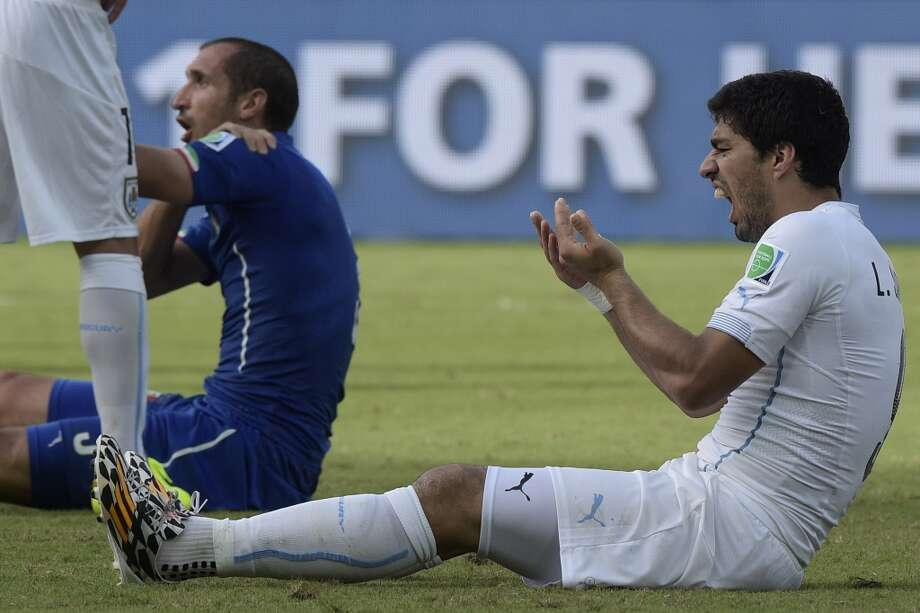 Uruguay's forward Luis Suarez reacts during a Group D football match between Italy and Uruguay at the Dunas Arena in Natal during the 2014 FIFA World Cup on June 24, 2014. Uruguay won 1-0. Photo: DANIEL GARCIA, AFP/Getty Images