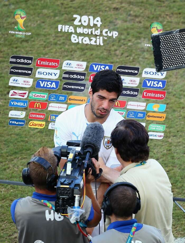 Luis Suarez of Uruguay is interviewed after the 2014 FIFA World Cup Brazil Group D match between Italy and Uruguay at Estadio das Dunas on June 24, 2014 in Natal, Brazil. Photo: Julian Finney, Getty Images