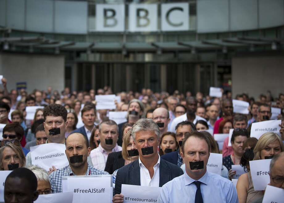LONDON, ENGLAND - JUNE 24:  BBC staff and colleagues from other news organisations take part in a one-minute silent protest outside New Broadcasting House against the seven-year jail terms given to three al-Jazeera journalists in Egypt  on June 24, 2014 in London, England.  A court in Cairo found al-Jazeera's Cairo bureau chief, Mohamed Fahmy, who is Canadian-Egyptian, Egyptian producer Baher Mohamed and Australian correspondent Peter Greste guilty of spreading false news.  (Photo by Rob Stothard/Getty Images) *** BESTPIX *** Photo: Rob Stothard, Getty Images