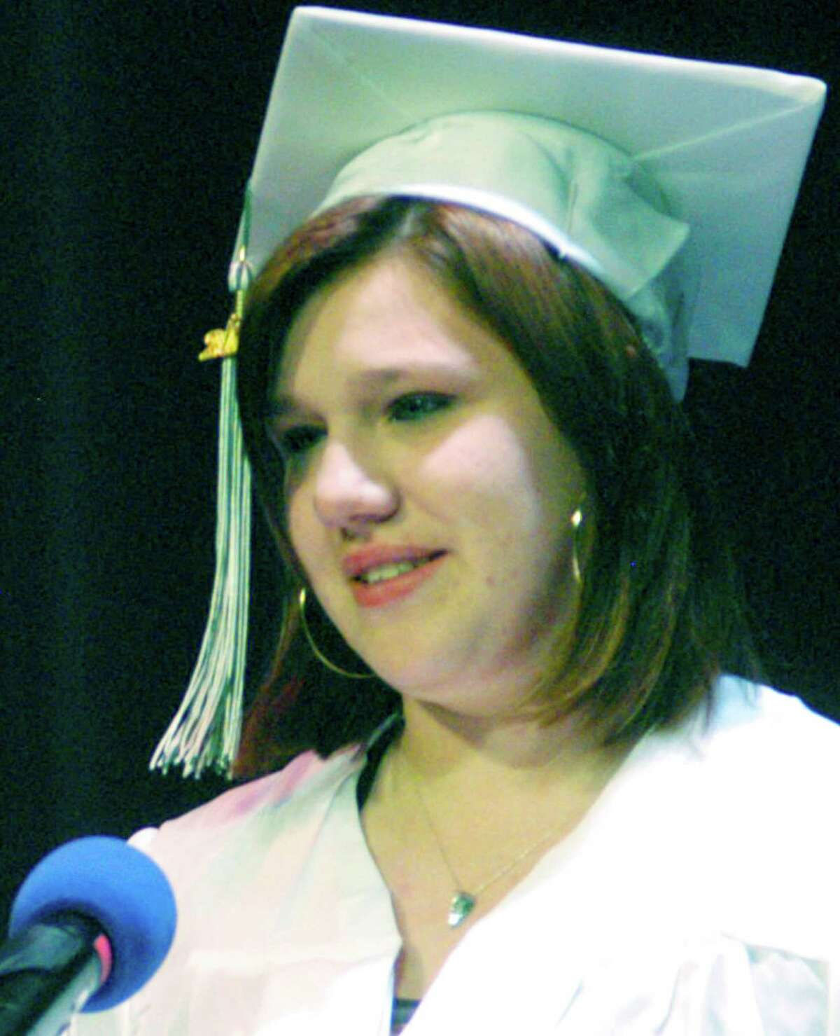 Honored speak Deborah Fiala offers emotional perspectives on her own path to a degree during New Milford adult education commencement exercises at the school, June 11, 2014.