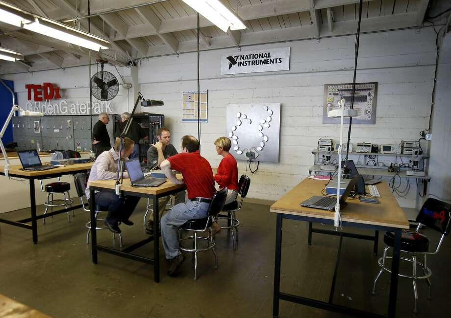 Engineers work on projects at TechShop, the fabrication studio that provides ample tools for testing. Photo: Brant Ward, San Francisco Chronicle