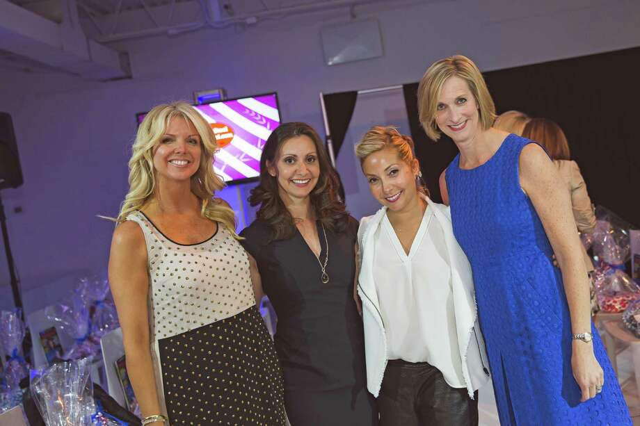 The Young Women's League of New Canaan hosted its third annual Couture for a Cause on May 9. Above, co-chairmen Nancy Roeder, Anna Diamantis, Jenn Shulman and Amy Fields. Photo: Contributed Photo, Contributed / New Canaan News Contributed