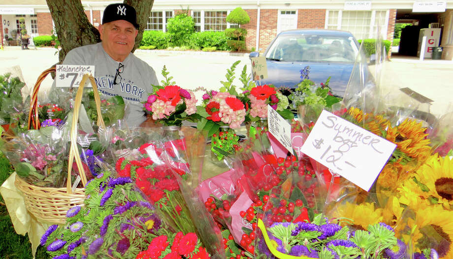 Freshly cut flowers were sold by Sal Pace of Coreen's Bridge Floral at the Greenfield Hill Farmers Market on Saturday. Photo: Mike Lauterborn / Fairfield Citizen