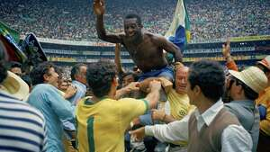 FILE - In this June 21, 1970 file photo, Brazil's Pele, centre is hoisted on the shoulders of his teammates after Brazil won the World Cup soccer final against Italy, 4-1, in Mexico City's Estadio Azteca, Mexico. On this day: Perhaps the most glorious day in Brazil's World Cup history. Its third World Cup triumph against a strong Italian side meant it kept the Jules Rimet trophy for good.