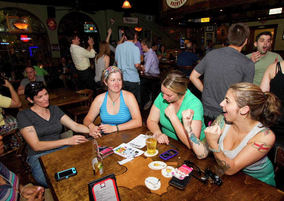 Ryanne Henigar, Stephanie Turner, Lizzy Fries and Juliet Moths, right, react as they play a trivia game at Maple Leaf Pub. Photo: Cody Duty, Houston Chronicle / © 2011 Houston Chronicle