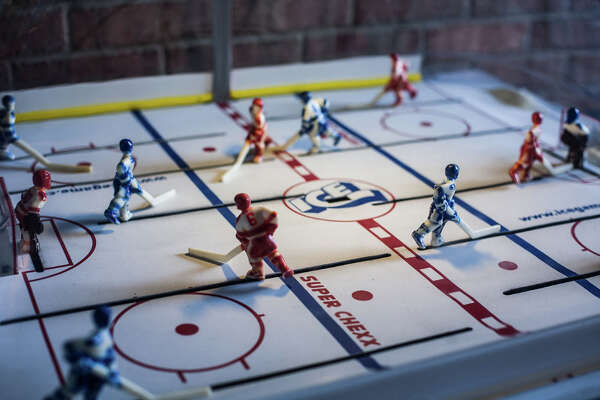 A hockey arcade game sits near the entrance of The Maple Leaf Pub.