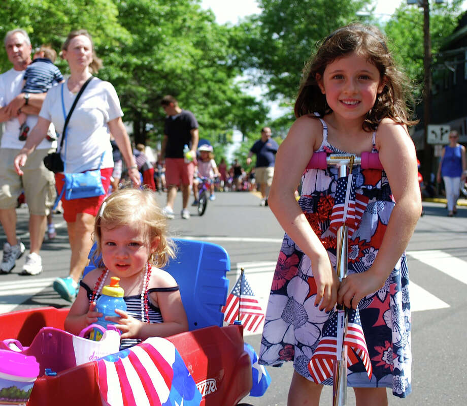 Piper and Lauren Savino participate in the 2013 Push-n-Pull Parade in Darien, Conn. The event, presented by the YWCA Darien/Norwalk, returns Friday, July 4, 2014, for its 10th year. Prizes will be awarded for the most imaginative decorations of nonmotorized vehicles. For more information on entering, visit ywcadariennorwalk.org or call 203-655-2535. Photo: Contributed Photo / Stamford Advocate Contributed photo